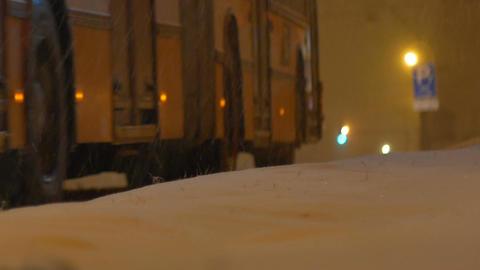 Nighttime Snowing Bus Footage