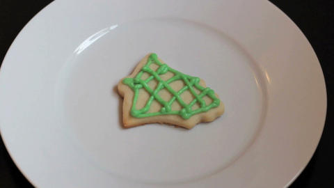 Adding Red Icing To Bell Shaped Christmas Cookie Stock Video Footage