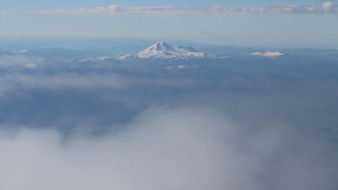 Aerial View Of Mount Baker Slipping Beneath Clouds Stock Video Footage