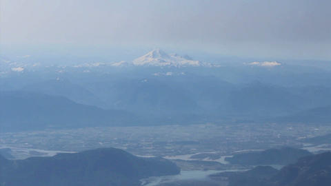 Aerial View Of Mount Baker Slipping Beneath Clouds Footage