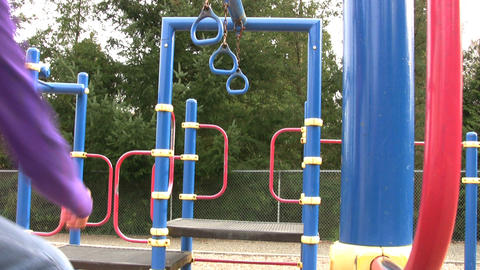 Asian Girl On Playground Rings Stock Video Footage