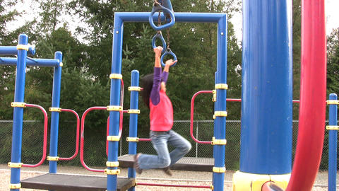 Asian Girl On Playground Rings Footage