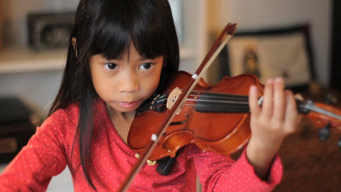 Asian Girl Practices Her Violin High Angle Footage