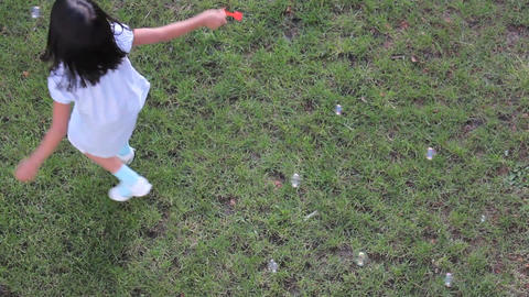 Asian Girl Spinning Around While Making Bubbles Stock Video Footage