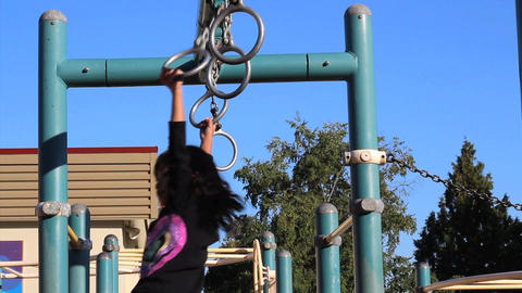 Asian Girl Using Old Style Playground Rings Stock Video Footage