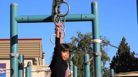 Asian Girl Using Old Style Playground Rings Footage