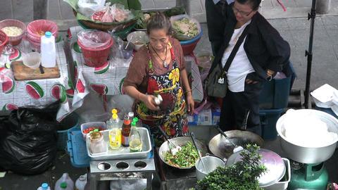 Asian Lady Cooking Thai Food On Sidewalk Stock Video Footage