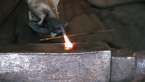 Blacksmith Flattening Metal Footage