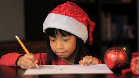 Cute Six Year Old Drawing Picture For Santa Claus Stock Video Footage