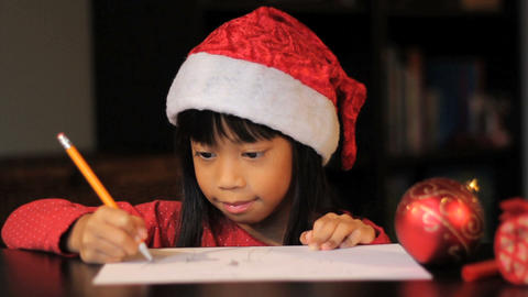 Cute Six Year Old Drawing Picture For Santa Claus Footage