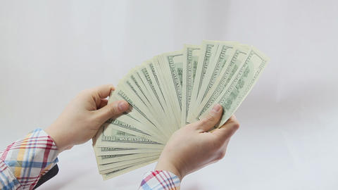 Man paying with american dollars on white background Footage