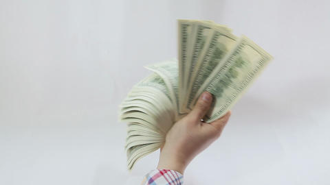 Man paying with american dollars on white background Stock Video Footage