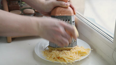 Man grating cheese for pizza, timelapse Stock Video Footage