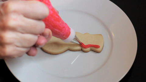 Decorating Snowman Shaped Christmas Cookie Stock Video Footage