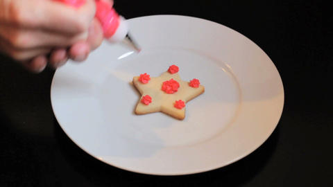 Decorating Star Shaped Christmas Cookie Stock Video Footage