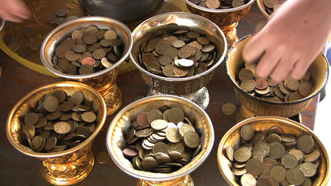 Filling Temple Containers With Coins stock footage