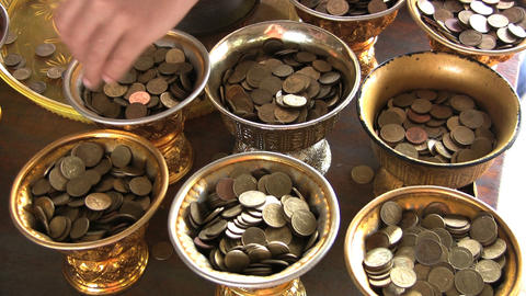 Filling Temple Containers With Coins Stock Video Footage