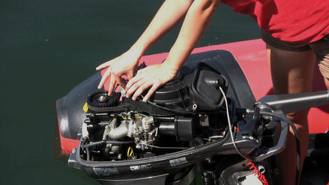 Fixing An Outboard Motor By The Ocean Stock Video Footage