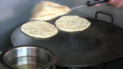 Frying Roti Bread Stock Video Footage