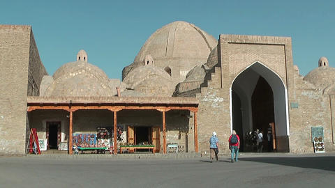 Tourists Walking To Trade Dome Tagi Zargaron 16-th Century In Bukhara, Uzbekistan stock footage