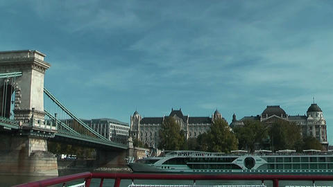 Sailing under the chain bridge in budapest on the danube Stock Video Footage