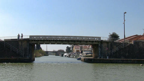 Vessel sails on the canal under the bridge Stock Video Footage