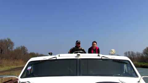 Men driving the boat Stock Video Footage