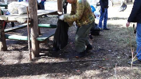 Volunteer removes debris Footage