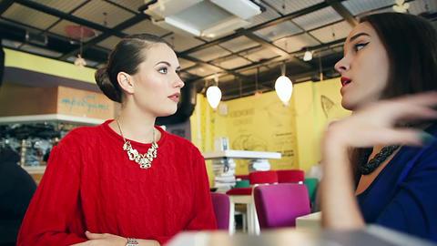 Two female friends enjoying evening coffee Image