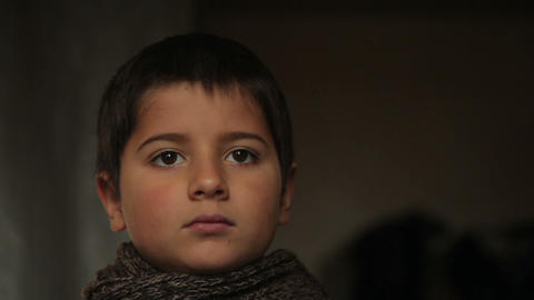 boy in a brown scarf Image