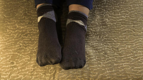 Dress socks on baby's feet Live Action