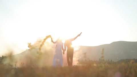 Bride and groom in field Footage
