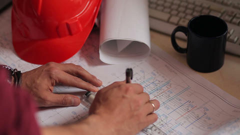 hands work with the drawings and blueprints Footage