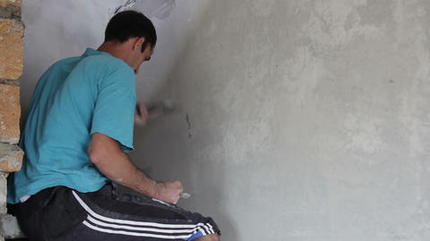 Painter put putty on the wall Footage