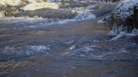 A beautiful crystal clear river in winter. Slow motion video Footage
