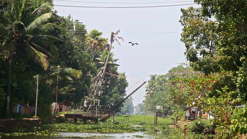 Motion along River with Plants to Lifting Drawbridge in Tropics Footage