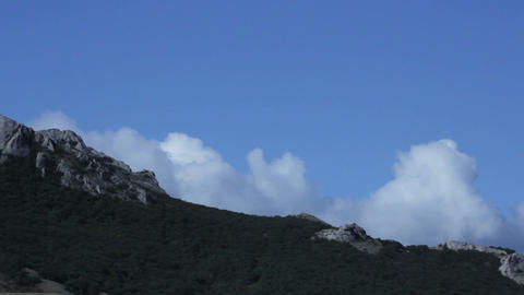 clouds fly over the rocks Stock Video Footage