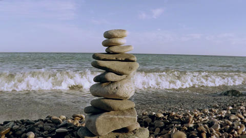 Stone tower on a seashore Live Action