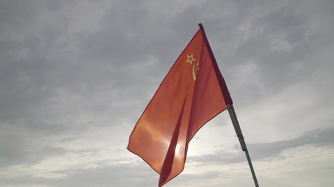 The USSR flag waving in slow motion against sky, slo mo, close up Footage