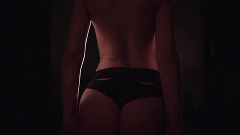 Sexy elegant woman undressing back to camera Footage
