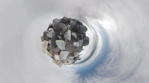 Sea and rocks. Rolling Tiny Little Planet Footage