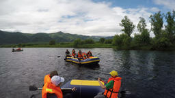 Rafting on Kamchatka: tourists and travelers floating on river on raft Footage