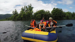 Summer rafting: group of tourists and travelers floating on calm river on raft Footage