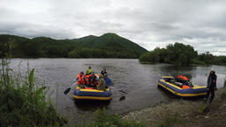 Rafting boat with tourists and travelers on board approaching the shore Footage