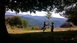Kids playing, mountain range Footage