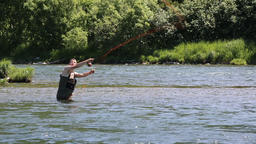 Fisherman fly fishing in cold water in mountain river Footage