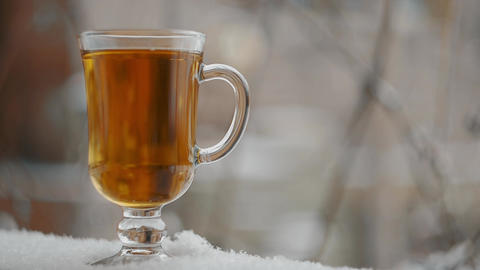 Steaming Cup Of Hot Tea In Snowy Winter ビデオ