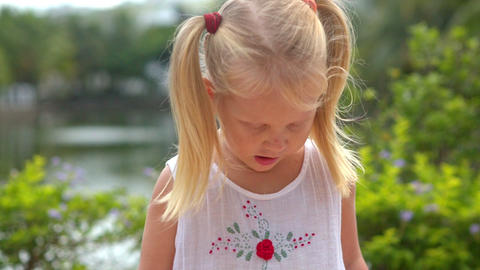 Closeup Little Blond Girl Smiles Shows Thumb Looks into Camera Footage