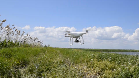 Rise quadrocopters low from the ground in strong winds. Wind resistance of Footage