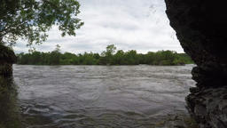 Cold mountain river with muddy water in dismal weather Footage